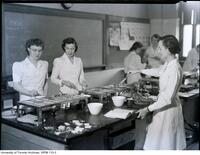 Students cooking in the Household Economics lab